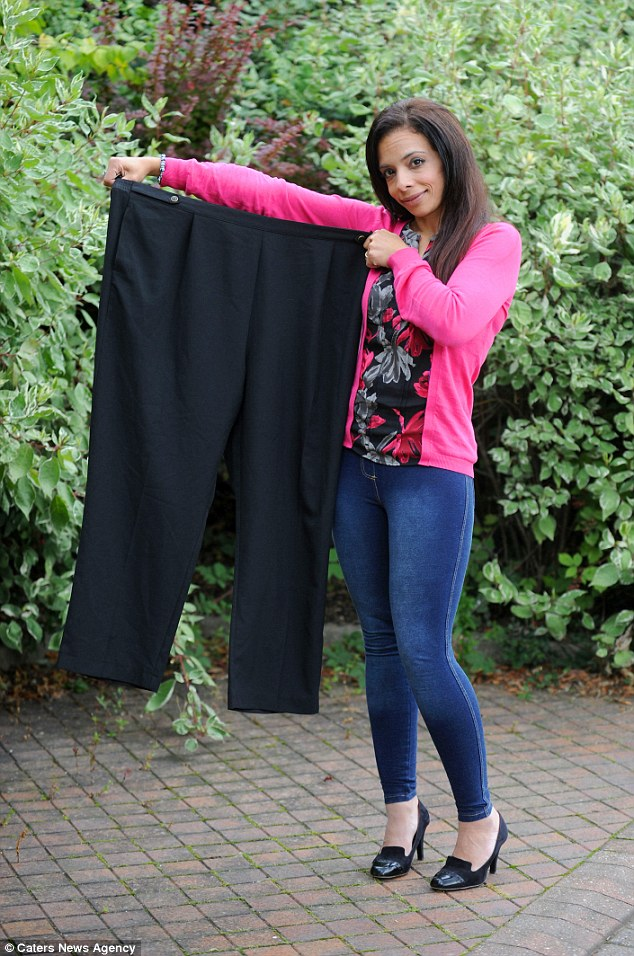 "Noha after shedding the pounds , holding her ""Billy Jean"" Pants."