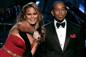LAS VEGAS, NV - MAY 17:  Hosts Chrissy Teigen (L) and Ludacris speak onstage during the 2015 Billboard Music Awards at MGM Grand Garden Arena on May 17, 2015 in Las Vegas, Nevada.  (Photo by Ethan Miller/Getty Images)